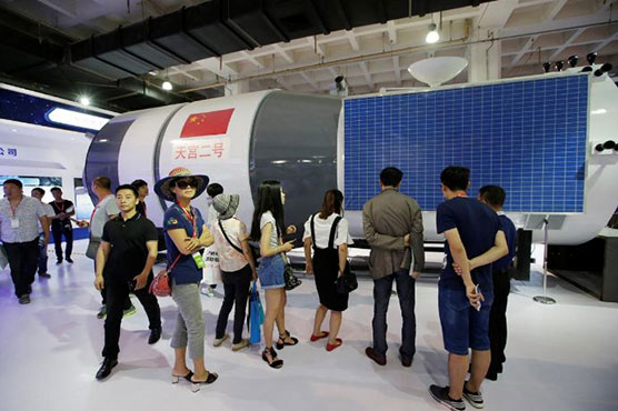 China's manned space lab to re-enter atmosphere on Friday
