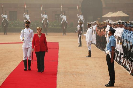 Maskless Angela Merkel braves severe Delhi smog