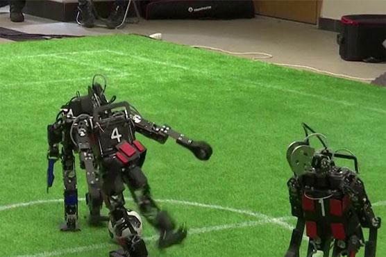 Messi, Ronaldo step aside: robots go on a kickabout