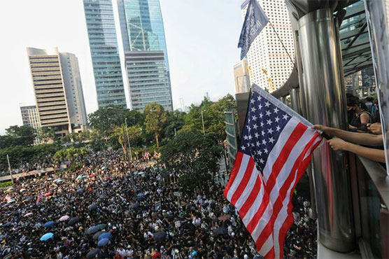 Clashes after peaceful crowd takes Hong Kong message to US