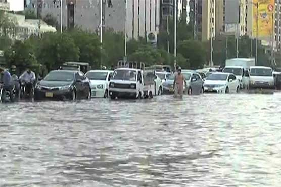 Authorities fail to drain out rain water from Karachi roads after six hours