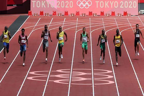Lyles leads impressive US trio into 200 metres Olympic semis