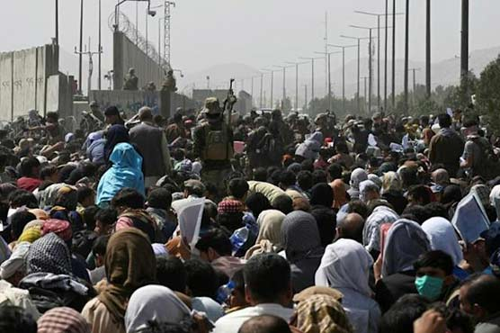 Taliban blame US for airport chaos as Afghans face 'impossible' race to flee