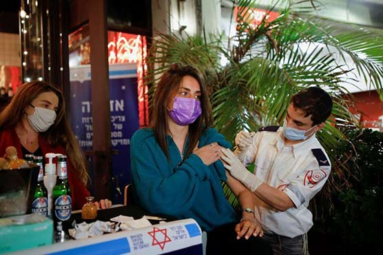 Jab but no tab: Israeli bar offers free drinks with vaccine shots