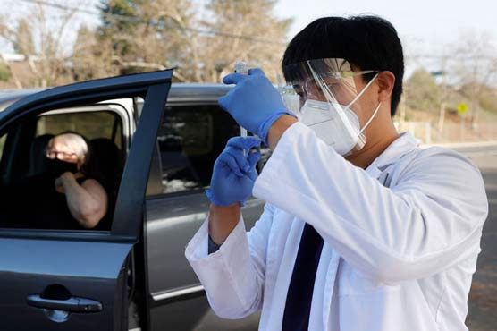 Nonprofit holds drive-thru vaccination clinic