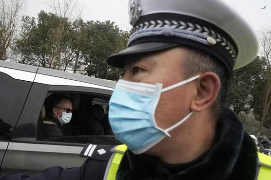 WHO probe team visits Wuhan market at heart of first virus outbreak