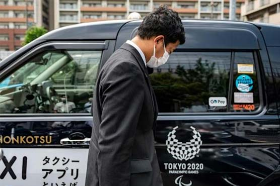 Tokyo's taxi drivers face fan-free Olympics