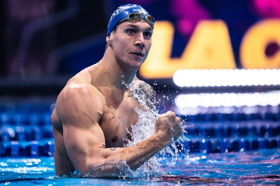 Dressel outpaces Chalmers in 100m free heats in gold medal quest