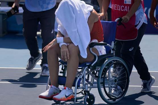 Heatstroke victim Badosa leaves court in wheelchair at Olympics