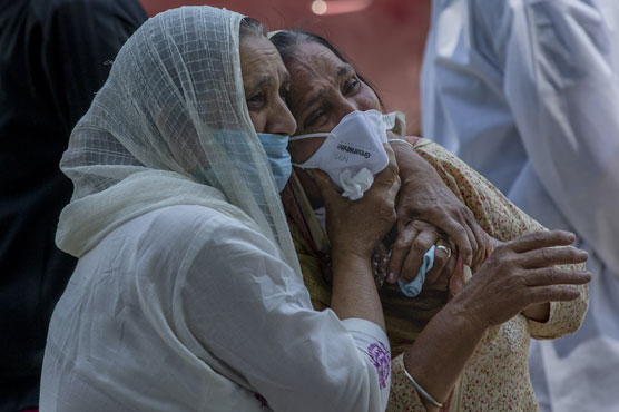 India posts record new Covid deaths after data revision