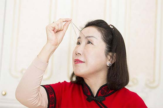 Chinese woman with world's longest eyelash breaks her own record