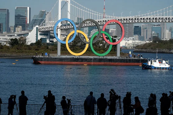 Japan to lift virus emergency one month before Olympics