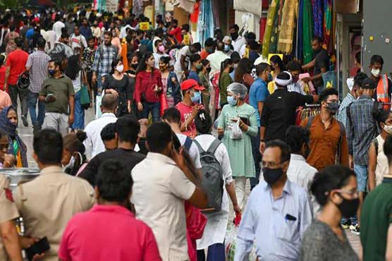 'Cooped up' Indians throng malls and markets weeks after Covid surge