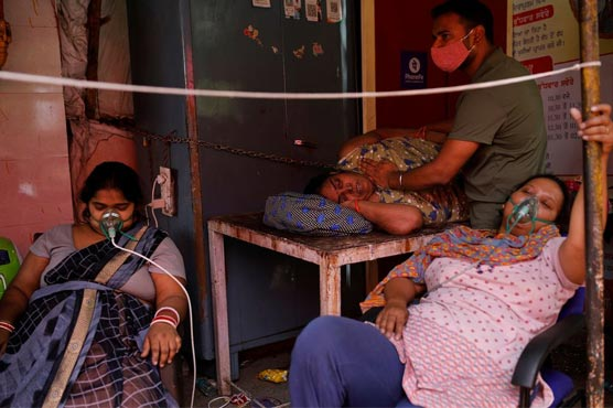 India expands faltering vaccine drive as new cases soar