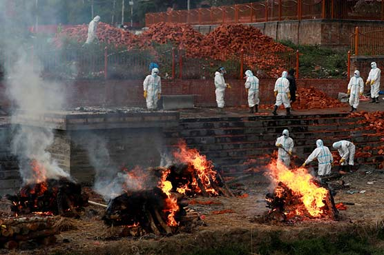 As COVID-19 rages in India, scientist warns further waves 'inevitable'