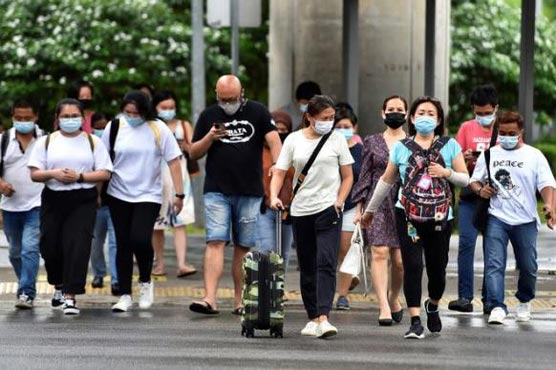 WHO urges caution over removing mask mandate for vaccinated people