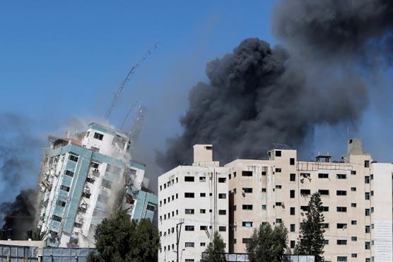 Israel flattens Gaza building hosting AP, Al-Jazeera in air strike