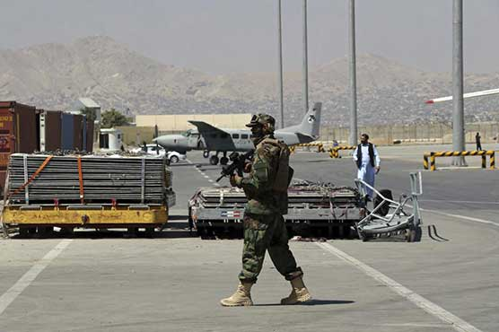 Scores of Westerners, including Americans, fly out of Kabul