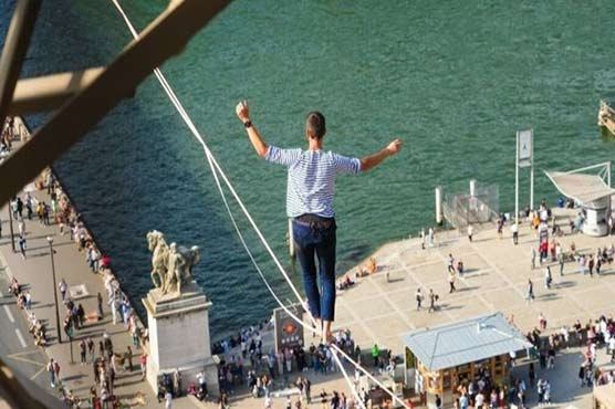 French daredevil takes hair-raising Seine tightrope walk