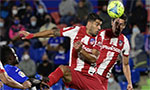 Suarez fires Atletico top with late double at Getafe