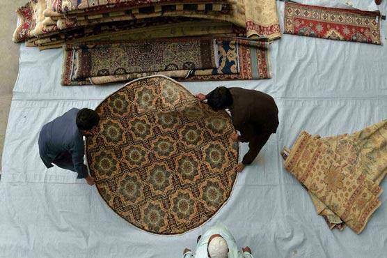 Kabul's carpet and antique dealers struggle after foreigners flee