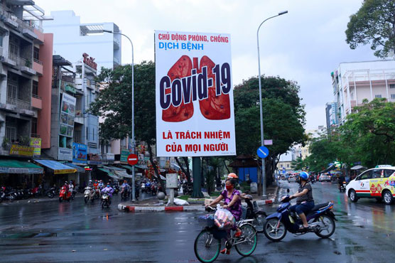 Vietnam's biggest city to start lifting COVID-19 curbs to revive business